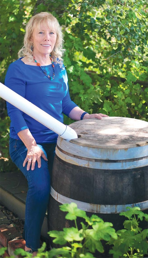 Carmel Valley resident Zephyr Miller outfits old wine barrels to collect rain from her roof