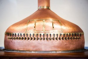 The centerpiece of the bar is a 25 tap copper kettle